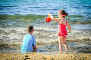 kids enjoy beach activities in dublin and play with water